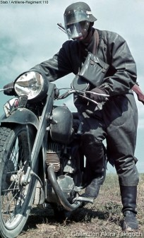The ubiquitous German motorcycle messenger (Kradmelder) from Stab Artillerie-Regiment 110 in the Eastern Front with his DKW NZ 350, wearing his rubberized coat (Kradmantel) that has been wrapped and buttoned around his legs to keep dirt and dust off his uniform.