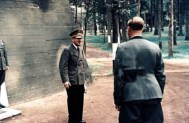 Adolf Hitler (Führer und Reichskanzler des Grossdeutschen Reiches) in front of a newly built bunker at his Führerhauptquartier 'Wolfsschanze' near Rastenburg, East Prussia, 18 September 1944. With the back to the camera is his personal adjutant, SS-Obersturmführer Otto Günsche.