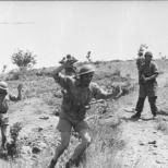 British soldiers surrender to German paratroopers.