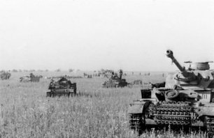Panzer IIIs and IVs advance against the southern face of the salient.