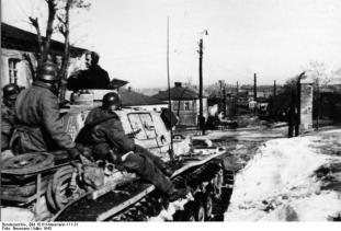Waffen-SS soldiers aboard a Panzer IV in Kharkov, March 1943.