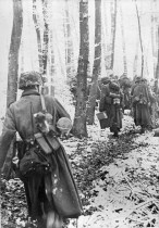 German infantry travel on foot in the Ardennes, December 1944.