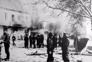 SS German troops in front of buildings set ablaze during the Distomo massacre.