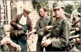 German troops, accepting a drink from a French villager somewhere in Normandy.