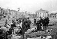 German wounded soldiers and civilians are being taken care of in front of the Brandenburger Gate, early May 1945.