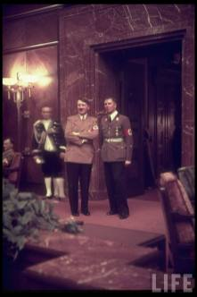 Adolf Hitler and Albert Bormann at party reception at Führerbau, 25 February 1939.