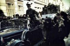 People enthusiastically greet Hitler on a ride through Münich in a Mercedes-Benz 770 open car, 1942. Standing in the back seat is his personal Adjutant, SS-Untersturmführer Otto Günsche.