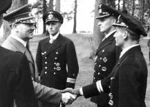 The Führer greets and awards the Knight's Cross of the Iron Cross with Oak Leaves to the heroes of Kriegsmarine Uboat commanders Heinrich Liebe of U-38, Herbert Schultze of U48, and Engelbert Endrass of U46.