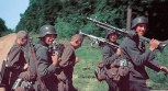 German soldiers armed with MG 34s and Kar 98 rifle escorting two Russian POWs, 1941.