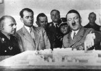 Adolf Hitler discussing plans for a new administration building for the provincial government in Weimar, Germany.Second from the left is Hitler's architect Albert Speer.