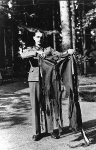 A soldier holding the trousers Hitler wore during the failed assassination attempt.