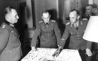 Generalfeldmarschalls Gerd von Rundstedt and Erwin Rommel meet in Paris.