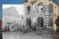 In the first picture, a man stands near the town hall of Vareddes, France, on March 12, 2014. In the second photo, German troops are taking a rest on the steps of the same building during the first battle of the Marne in 1914.