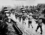 American soldiers cross the Siegfried Line and march into Germany.