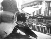 Captured V-2 on public display in Antwerp, 1945. Exhaust vanes and external rudders in tail section shown.