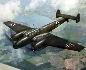 Black painted Messerschmitt Bf 110 in the sky.