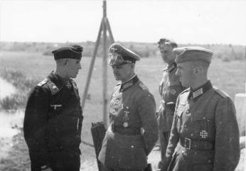 Model (centre) as Commander of the 3rd Panzer Division on the Eastern front in discussion with Buchterkirch, July 1941.