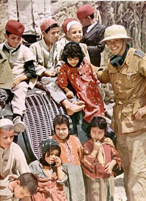 Afrikakorps soldier and Arab children.
