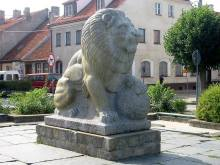 A sculpted lion, which once topped a 6-metre (20 ft) pillar at the entrance of the Tannenberg Memorial and is now displayed in the Olsztynek town square