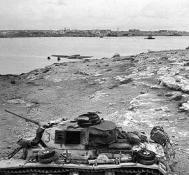 Knocked out Panzer III with a plane in the water.