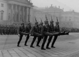 Luftwaffe soldaten goose stepping in review/parade formation.