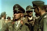 Erwin Rommel between his soldiers. Major Günther Schrivenbach standing behind him, holding a fernglas in his hand.