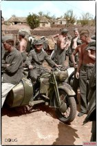 German soldiers gather around a French Gnome et Rhône AX2 800 motorcycle and side car in Belgorod, Russia, Summer 1943.