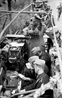 Heinz Guderian with an Enigma machine in a Sd.Kfz. 251 half-track being used as a mobile command center during the Battle of France.