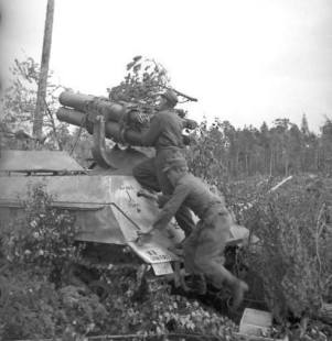 Panzerwerfer crew prepares to launch battery.