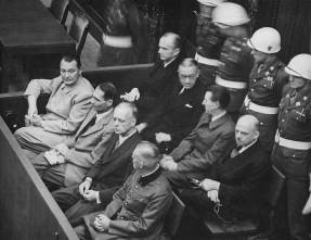 Göring (first row, far left) at the Nuremberg Trials.