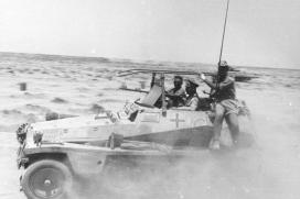 """Rommel amidst advancing units in his Sd.Kfz. 250 command vehicle """"GREIF"""" (Engl. 'Griffin')."""