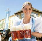 A Bavarian woman holding glasses of Hacker-Pschorr, one of the few traditional beer brands that are allowed to be served at Oktoberfest.