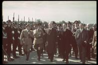 British Prime Minister Neville Chamberlain (1869 - 1940) (front row, second right) walks with past an SS honor guard at his reception upon arriving at Oberwiesenfeld airport on the way to a meeting with Adolf Hitler over the latter's threats to invade Czechoslovakia, September 28, 1938. Pictured are, from left, German politician Gauleiter Adolf Wagner (1890 - 1944), German SA-Obergruppenf?hrer Franz Ritter von Epp (1868 - 1947), German Foreign Minister Joachim von Ribbentrop (1893 - 1946), Chamberlain, and British Ambassador to Germany Sir Neville Henderson (1882 - 1942).
