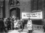 Nazi party members display election propaganda outside of a church in Berlin on July 23, 1933.