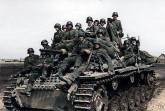 Panzer III with infantry.
