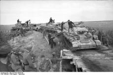 Panzer IV's crossing a makeshift bridge.