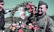 "Photo above was taken shortly before the return of Oberfeldwebel Helmut Benkendorff from his 500th feindflug, shows a staffel vehicle adorned with a wreath and the number 500, along with a gift basket and bouquet. In the basket is the Gruppe's ""Eagle"" emblem."