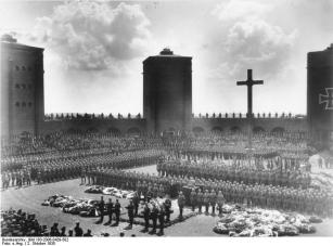 Hindenburg's original 1934 burial at the Tannenberg Memorial. Hitler is speaking at the lectern.
