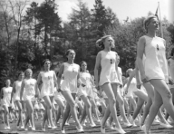 Young women belonging to the League of German Girls, the female division of the Hitler Youth, practice gymnastics, 1941.