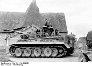 "Northern France Tiger I, tower number 131 of the first SS-Panzer-Korps ""Leibstandarte Adolf Hitler"" in a small town outside a church."