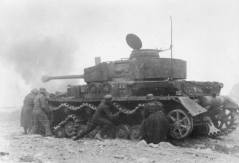 Panzer recovery crew tries to get a disabled Panzer IV moving again.