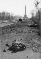 A dead soldier lies on the road... in the background the Siegessaule (the Column of Victory) is visible.