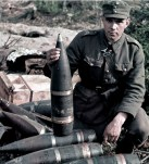 """A Finnish junior sergeant (Alikersantti) inspecting ammunition. The shells seem to be for 152 H/37 heavy howitzer (Soviet 152 mm Gaubitsa-Pushka obr. 1937 g. aka ML-20). The artillery shell under this NCO's hand is captured Soviet OF-540, better known by Finnish Army as """"152 p tkr 36/40-RG"""" (152-mm long TNT-filled high explosive shell with 36/40 fuse slot type -RG)."""