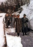 "Adolf Hitler (Führer und oberster Befehlshaber der Wehrmacht) walking in the snow alongside Heinrich Himmler (Reichsführer-SS und Chef der Deutschen Polizei) with aid of a walking stick at Berghof Berchtesgaden (Münich), 3 April 1944. Behind them were, from left to right: SS-Obersturmbannführer Fritz Darges (persönlicher SS Adjutant bei Adolf Hitler), SS-Hauptsturmführer Josef ""Sepp"" Kiermaier (persönlicher leibwächter bei Heinrich Himmler), unidentified, and SS-Brigadeführer und Generalmajor der Waffen-SS Hermann Fegelein (Verbindungsoffizier der Waffen-SS zum Führerhauptquartier). This picture was taken during the daily walk to the Mooslahnerkopf Teehaus (teahouse), a small building right across Hitler's Berghof mansion (this teahouse should not be mistaken with the official teahouse on top of the Kehlstein mountain), then the car took him back to the Berghof."