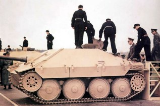 "Adolf Hitler (third from right, Führer und oberster Befehlshaber der Wehrmacht) inspecting one of the first twenty Jagdpanzer 38 (Sd.Kfz.138/2) ""Hetzer"" (Baiter or Troublemaker) during official presentation for the 55th Führer's birthday at Arys (Orzysz) in East Prussia, 20 April 1944."
