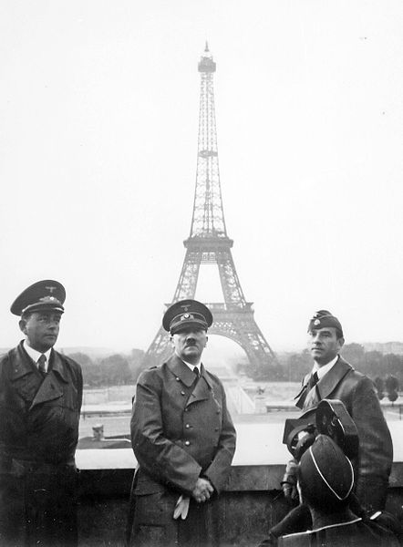 Tourist Hitler poses at the Eiffel Tower Albert Speer is at the left.