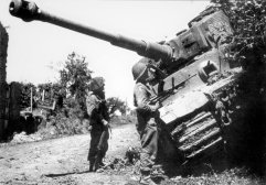 Knocked out Tiger 334 being inspected by allied soldiers in France.