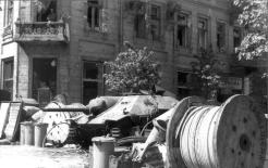 Barricade erected such on Napoleon Square. In background: captured Hetzer tank destroyer. 3 August 1944.