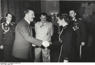 Adolf Hitler awards Hanna Reitsch the Iron Cross 2nd Class in March 1941.