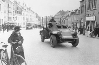 German armoured cars moving through a Danish town.